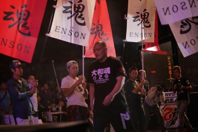 Enson Inoue exits the cage following his retirement ceremony at Vale Tudo Japan 6 in Tokyo, Japan.